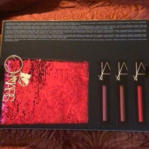 Nars Lip pigment set and red cosmetic bag.